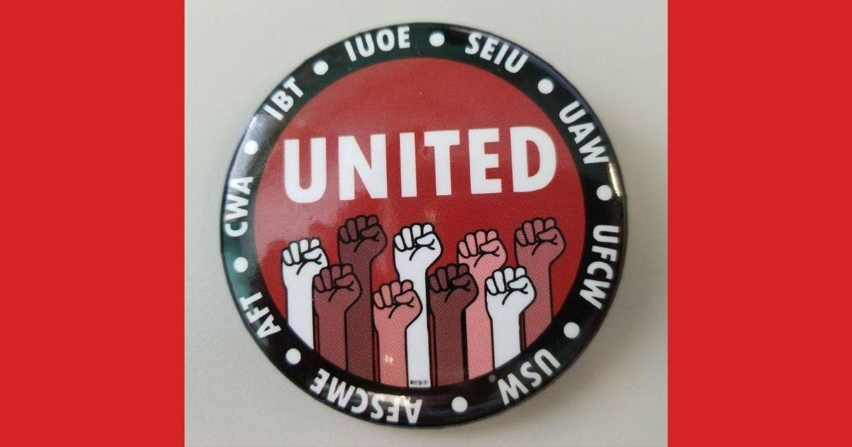 Raised fists with Red Cross Union Coalition